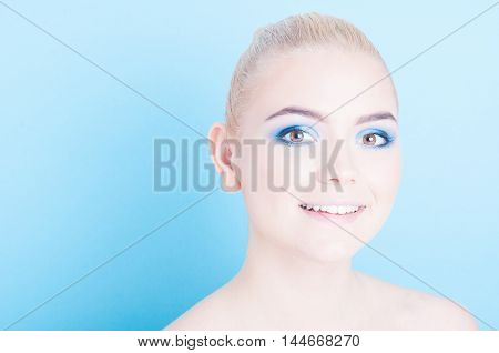 Young Girl Posing With Professional Colored Make-up
