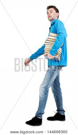 side view of going man carries a stack of books. walking young guy . backside view of person. Isolated over white background.