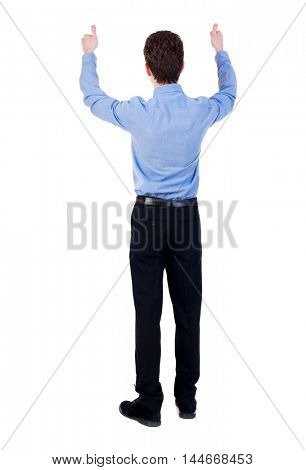 Back view of business man shows thumbs up. Businessman in a blue shirt raised his thumbs up.