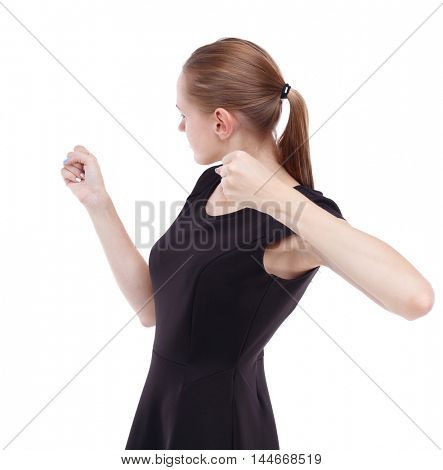 skinny woman funny fights waving his arms and legs. Blonde in a short black swung to strike.
