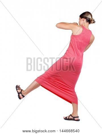 skinny woman funny fights waving his arms and legs. slender woman in a long red dress swinging leg