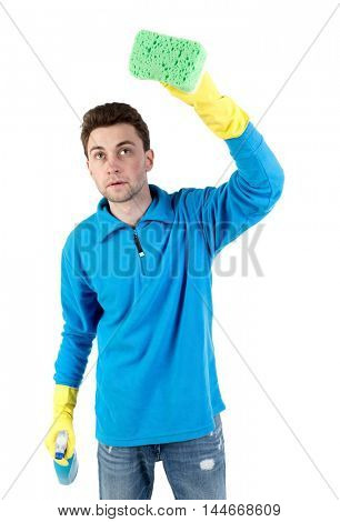 front view of a houseowner in gloves with sponge and detergent. man watching. curly-haired man in a blue jacket with warm sponge box.