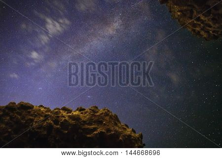 The Milky Way view from the ancient Roman ruins with walls constructed with the typical structure of a honeycomb.