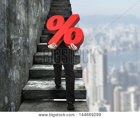 Man Carrying Percentage Sign Climbing On Old Concrete Stairs