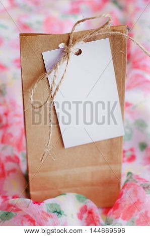 Kraft bag with gift inside with empty label for records