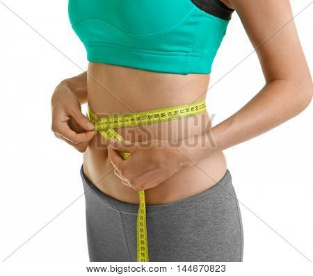 Girl with measure tape on white background