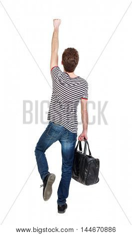 Back view of man with bag. Curly boy in a striped vest with a bag depicts a superhero.