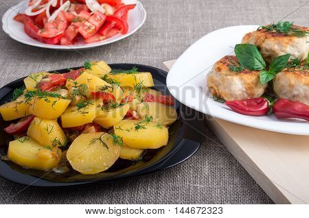 Stewed Potatoes, Meatballs Minced Chicken And A Salad Of Fresh Tomatoes