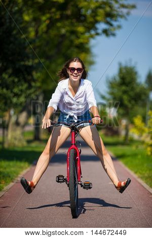 Urban bike - young woman riding bicycle in city