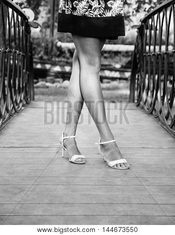 Feet girls on the bridge in black and white