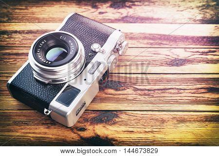 Retro vintage camera on wood table background. 3d illustration
