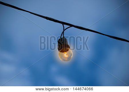 Incandescent lamp light in evening time outdoor