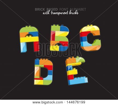 Alphabet created from playing bricks with some transparent elements.