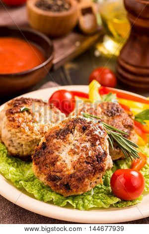 Fried meat cutlets on plate. Closeup shot
