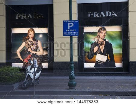 Hanoi, Vietnam - Aug 29, 2016: Outdoor view of a Prada store with advertising images in Hanoi capital. Prada is an Italian luxury fashion house, specializing in leather handbags, shoes, perfumes.