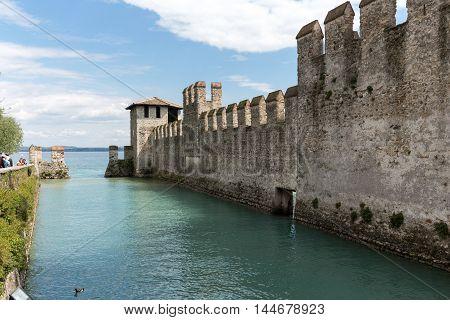 Castello Scaligero di Sirmione (Sirmione Castle) built in XIV century Lake Garda Sirmione Italy