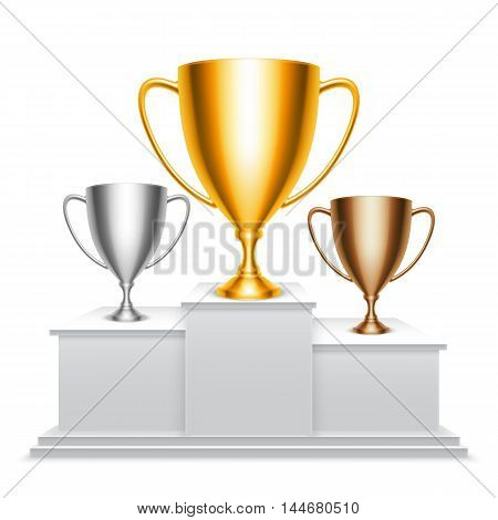 Golden, silver and bronze trophy cups on winners podium