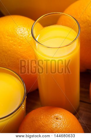 Glass of orange juice and fruits closeup