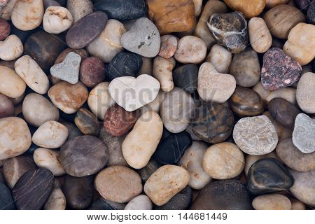 Hearth shape pebble stone colorful artistic background