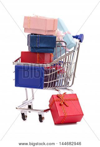 Grocery cart with gift boxes isolated on white