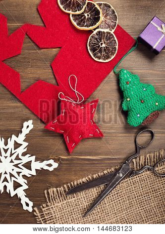 Hand crafted holiday decorations and vintage scissors top view vertical