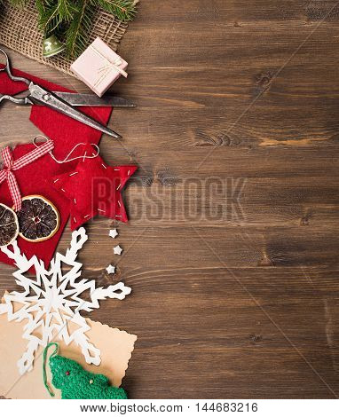 Handmade holiday decorations and vintage scissors at left side of table top view