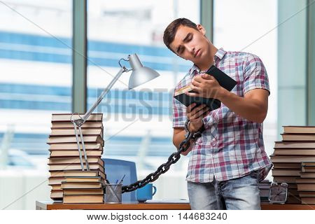 Young man preparing for graduation exams in college