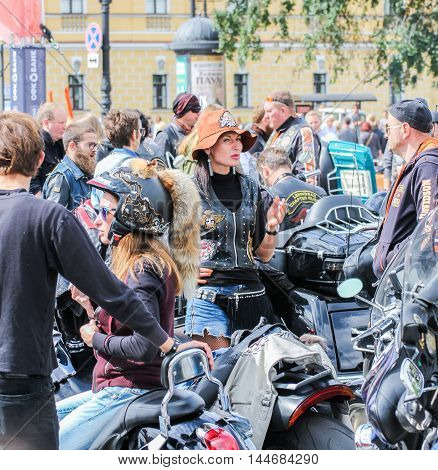 St. Petersburg, Russia - 13 August, Women and motorcycles,13 August, 2016. The annual International Motor Festival Harley Davidson in St. Petersburg.