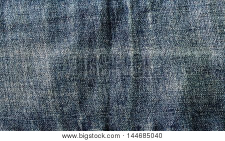 blue denim close up and a vertical seam