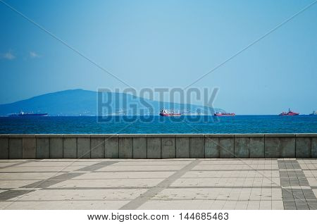 Marine background with ships in the distance. Seafront