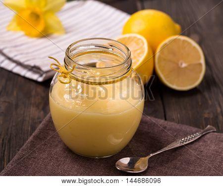 Jar of lemon curd on old table