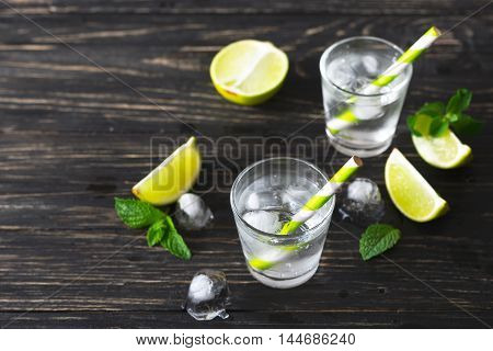 Cocktail With Soda Water, Ice, Lime And Mint