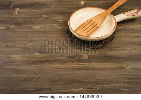 Kitchen utensils on wooden table top view