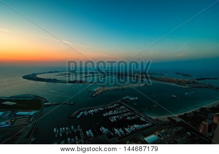 Majestic Colorful Dubai Palm Island During Beautiful Sunset. Amazing Dock With Several Luxury Yachts