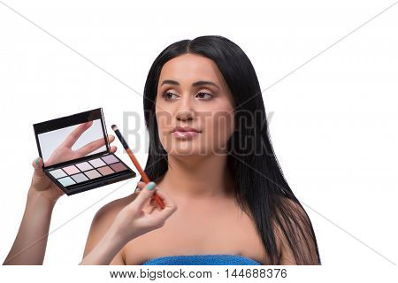 Young woman getting make-up isolated on white