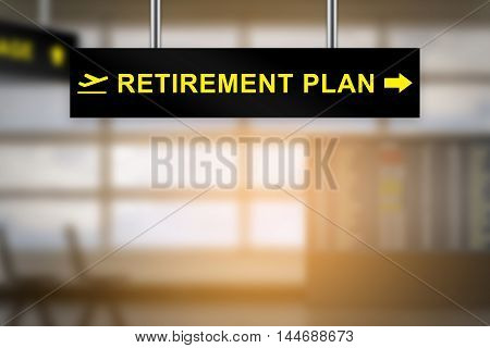 retirement plan on airport sign board with blurred background and copy space