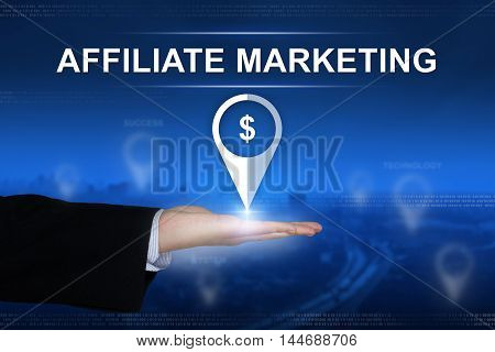 affiliate marketing button with business hand on blurred background