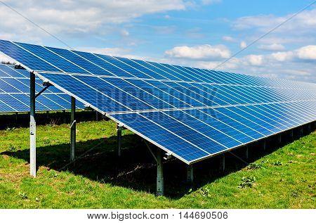 Solar panels on a green field. Western Europe