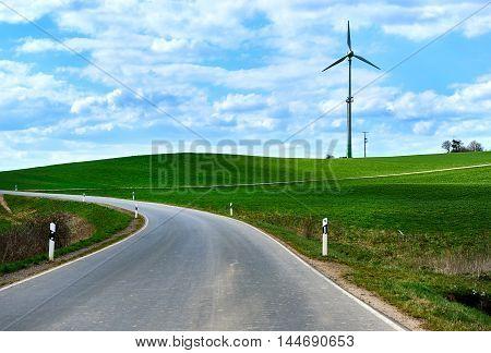 Rural winding road in springtime. Germany. Western Europe