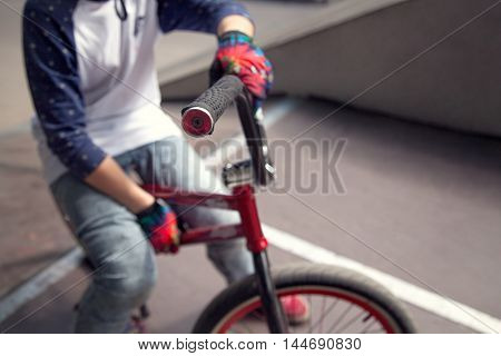 Young Bmx Bicycle Rider Sitting On A Ramp