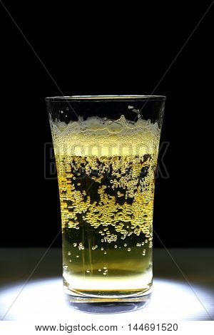Closeup of a glass of fresh foamy beer