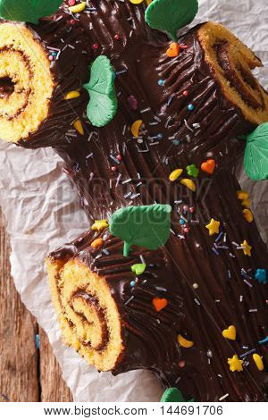 Christmas Chocolate Yule Log Cake On The Table Macro. Vertical Top View
