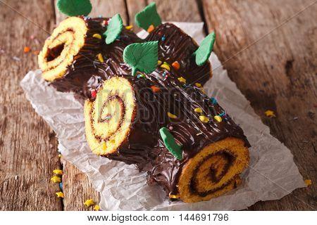 Christmas Chocolate Yule Log Cake On The Table. Horizontal
