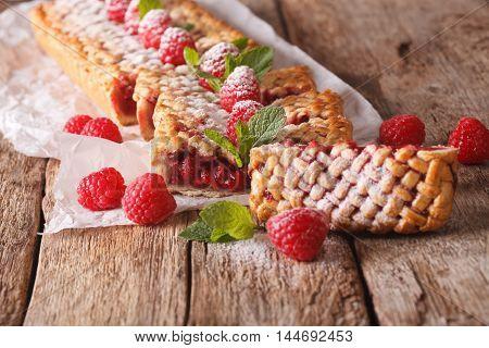 Sweet Sliced Pie Stuffed With Ripe Raspberry Close Up. Horizontal