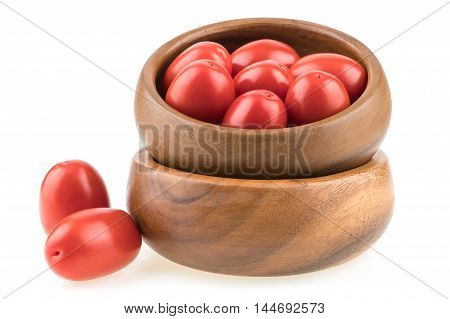 fresh tomatoes in wood bowl on white background. Selective focus.