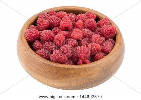 Raspberries in a wooden bowl. Ripe and tasty raspberries isolated on white background. Selective focus.