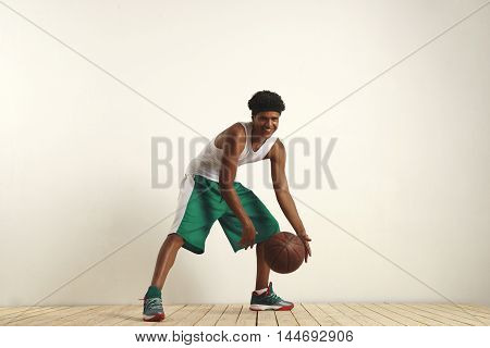 Fit Black Athlete Playing With A Vintage Basketball
