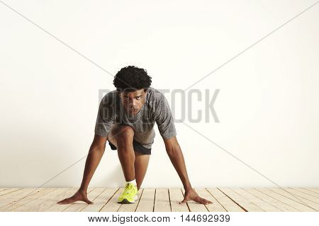 Young Sprinter Getting Ready To Start Running