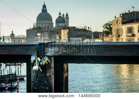Rialto bringe with padlock of love on Grand canal in beautiful city Venice Italy