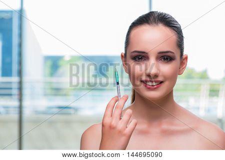 Beautiful woman preparing for botox injection
